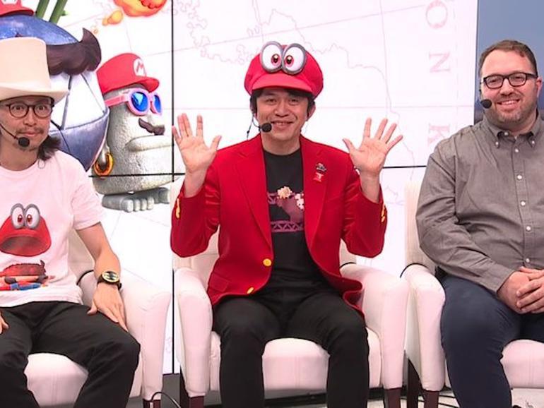 """Entwickler Koizumi wurde mit einem """"Donkey Kong""""-Retroshirt gesichtet und verteilte Pins mit ähnlichen Motiven"""